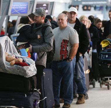 People waiting in line at an airport